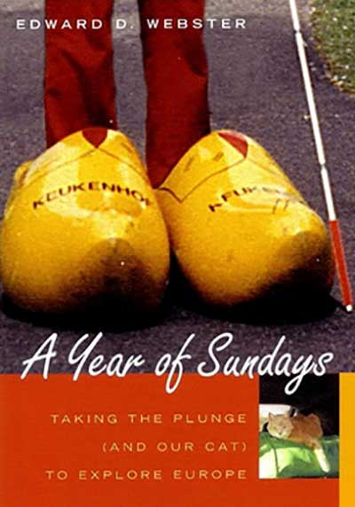 Front cover of the book A Year of Sundays, a travel memoir. The cover shows a person wearing huge yellow wooden shoes.